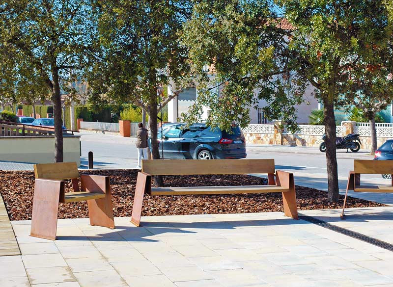 Modern wood and metal bench in public area