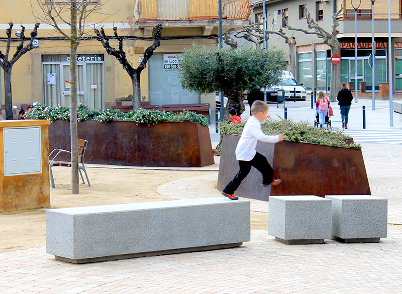 Long concrete block benches for outdoor seating