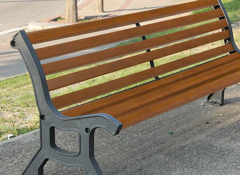 Traditional wooden slat park bench with iron frame