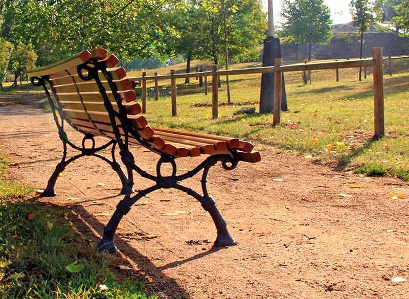 Multiple slatted park bench