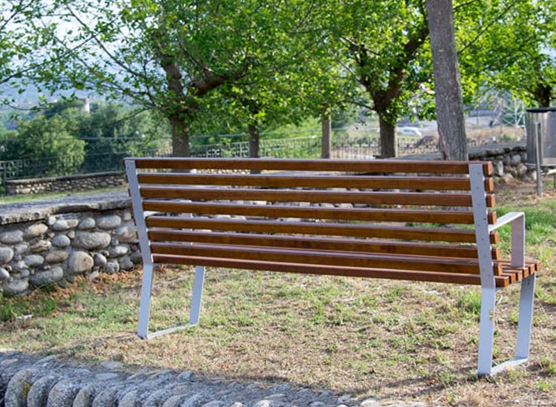 Classic public bench with wood slates and modern metal frame