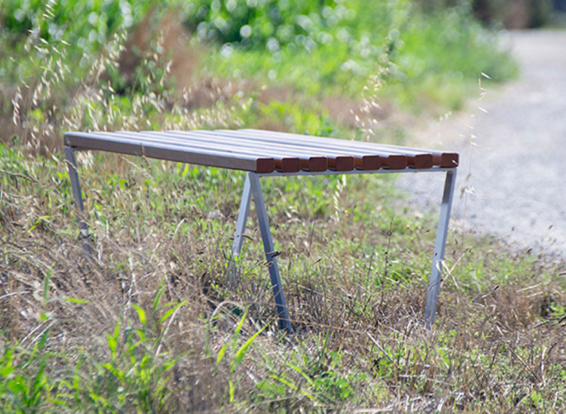 Backless wooden slat bench