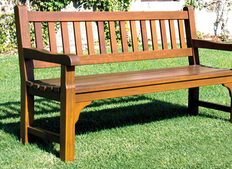 Outdoor bench made from treated pine wood on grass
