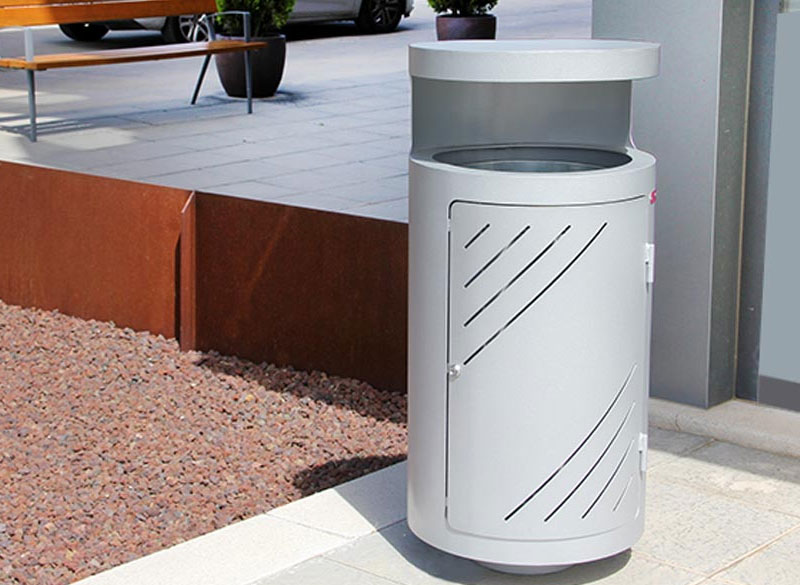 Circular metal litter bin with protective lid for outdoor communal areas