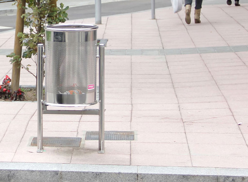 Striking stainless steel circular outdoor litter bin on legs
