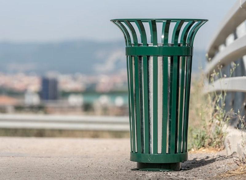 Green outside litter bin made from steel slats