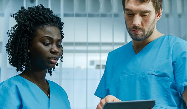 nurses looking at tablet