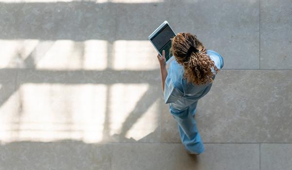 nurse viewing carerev on tablet