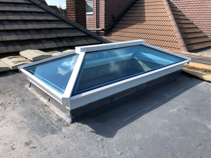 house with aluminium flat and lantern roofs