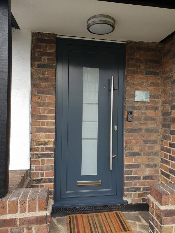 house with contemporary aluminium entrance doors