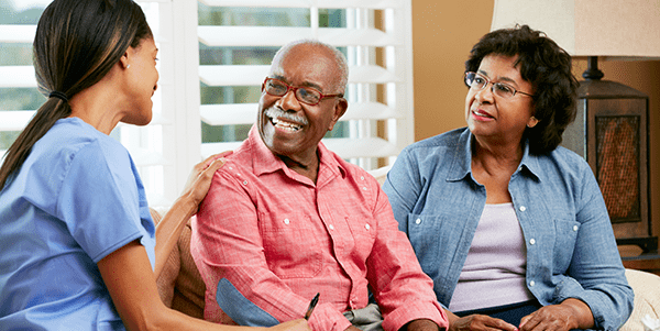 Man and wife receiving help with questions about BPH