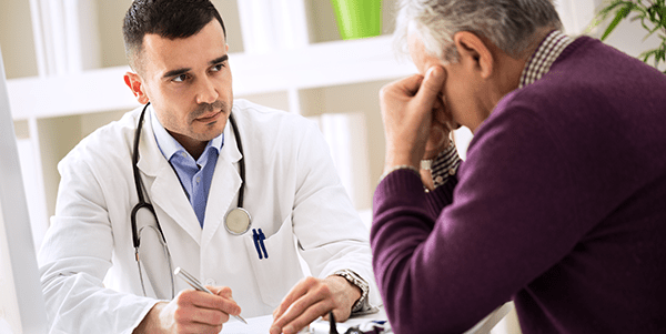 Doctor explaining to patient about BPH symptoms and available treatments