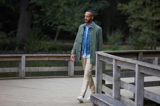 Man walking wearing fashionable clothing