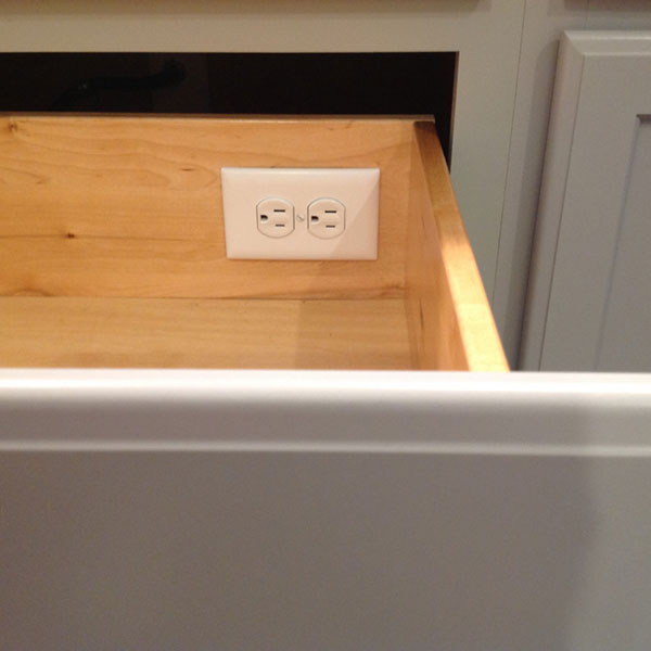 Receptacle installation in bath drawer