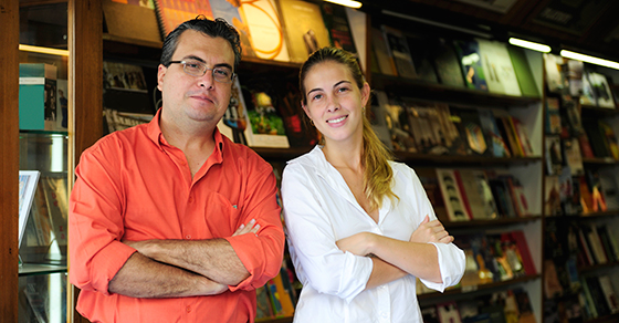father and daughter standing in bookstore