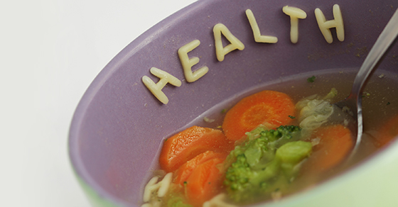 alphabet vegetable soup spelling out health on the bowl rim