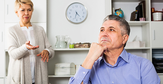 man looking off to the distance while woman gestures toward him