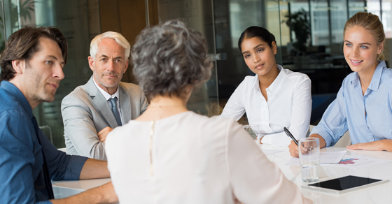 business people around conference table
