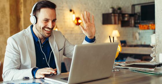 Man on laptop on virtual meeting