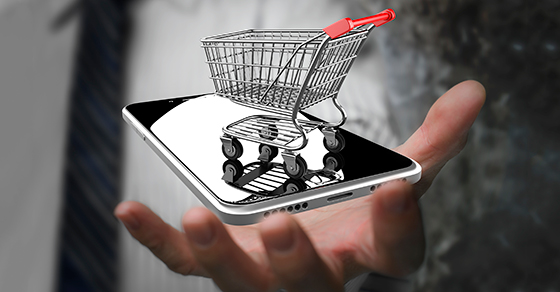 tiny shopping cart on smartphone
