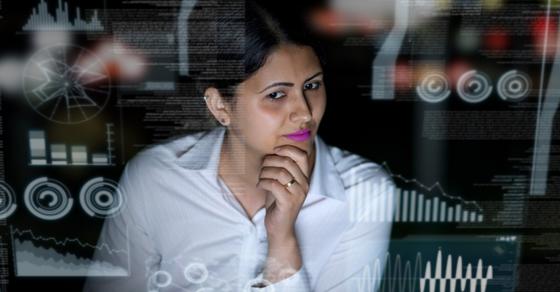 woman looking at computer analytics