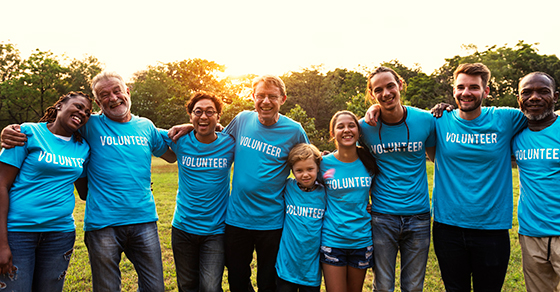 group of volunteers wearing matching blue tshirts