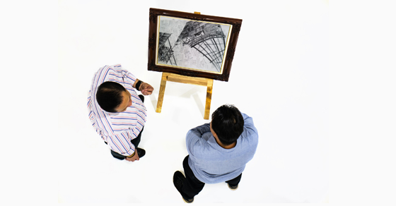 overhead view of two men looking at art
