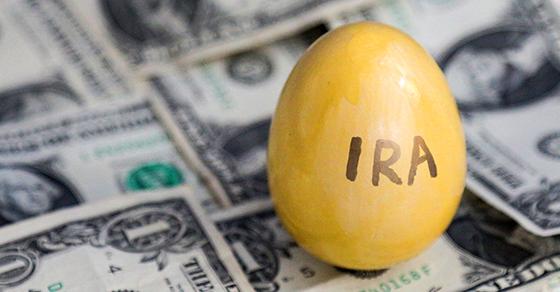 yellow egg reading IRA on dollar bills