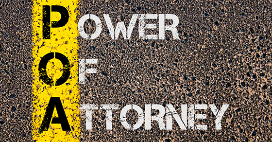 """power of attorney"" spray painted on asphalt"