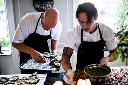 two men working in kitchen