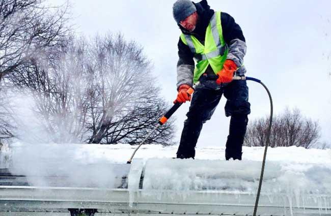 removing an ice dam from a framingham home