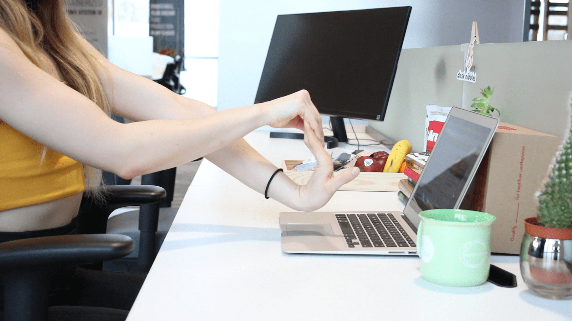 Pull back the wrist, but not too far to soothe office aches from typing