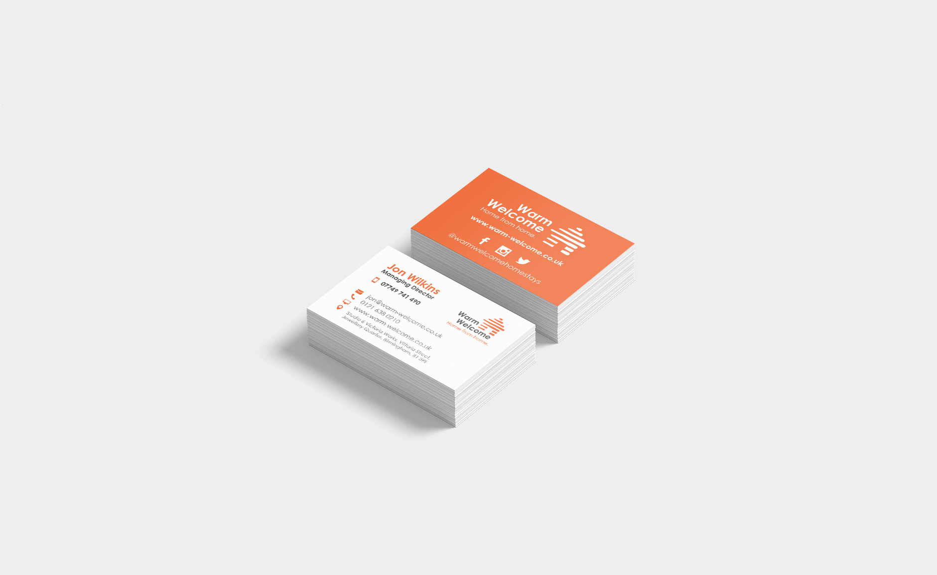 mockups of business cards produced by paddle creative. On a square background with cards stacked