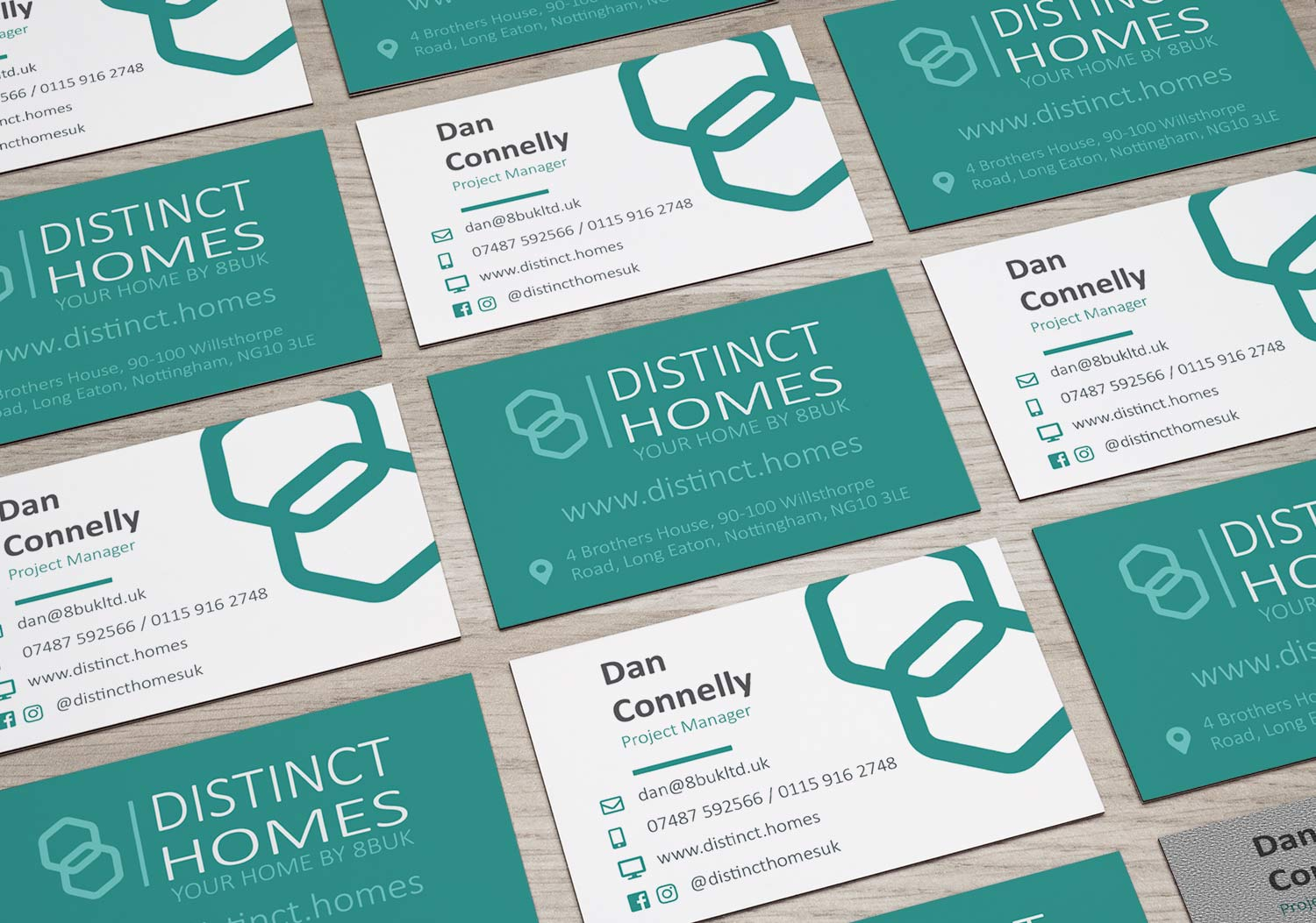 distinct homes business cards laid out on a table showing front and back as part of a branding exercise