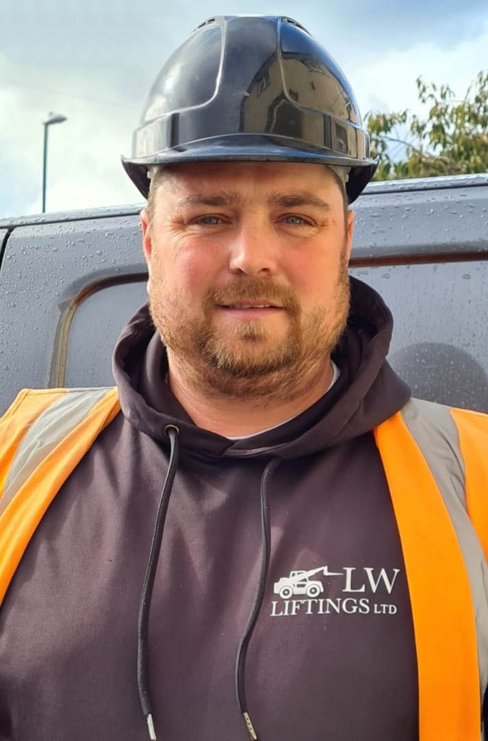 lee wood founder of lw liftings in builders outfit with hard hard and high vis vest