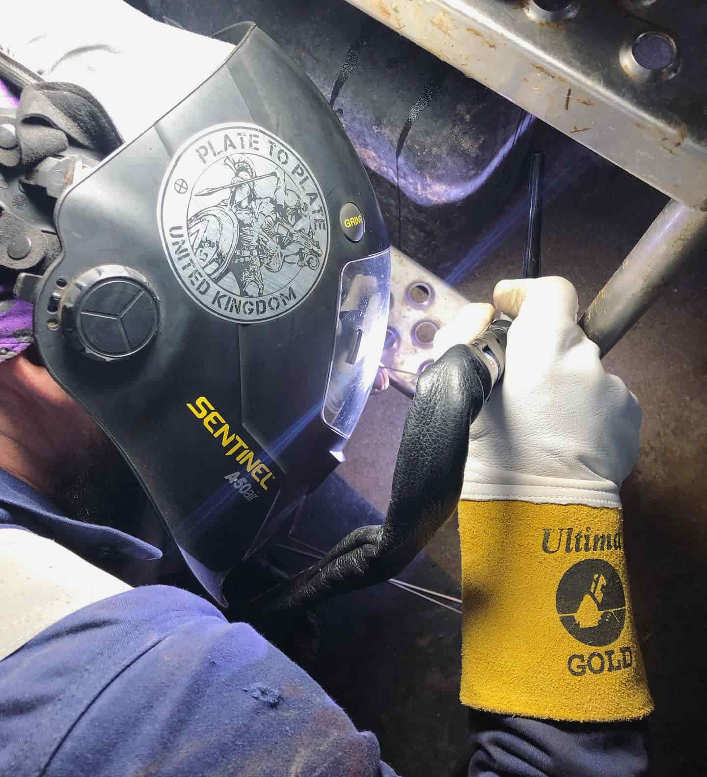 wilson and daughter welding welder in action with sparks and mask