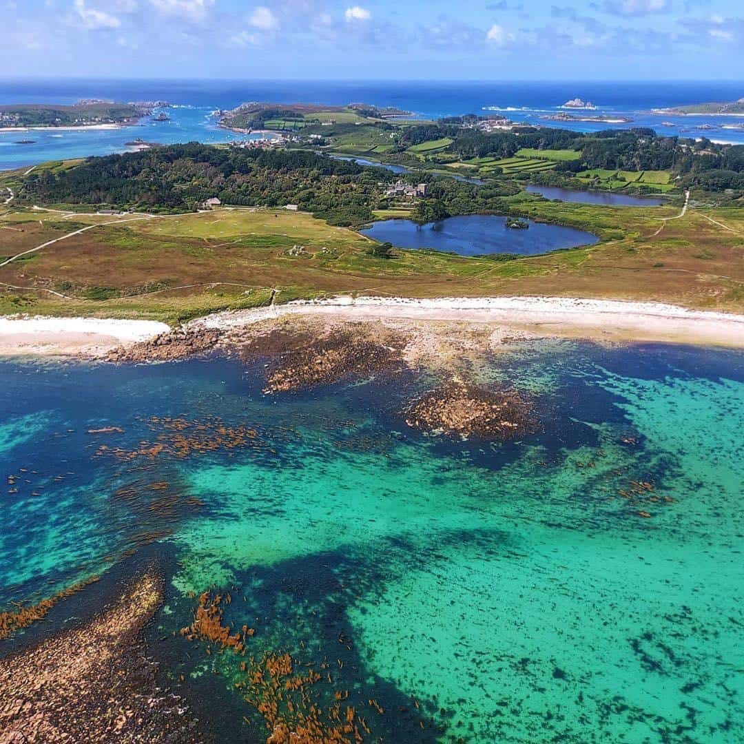 isles of scilly taken from above with turqoise waters on sunny day