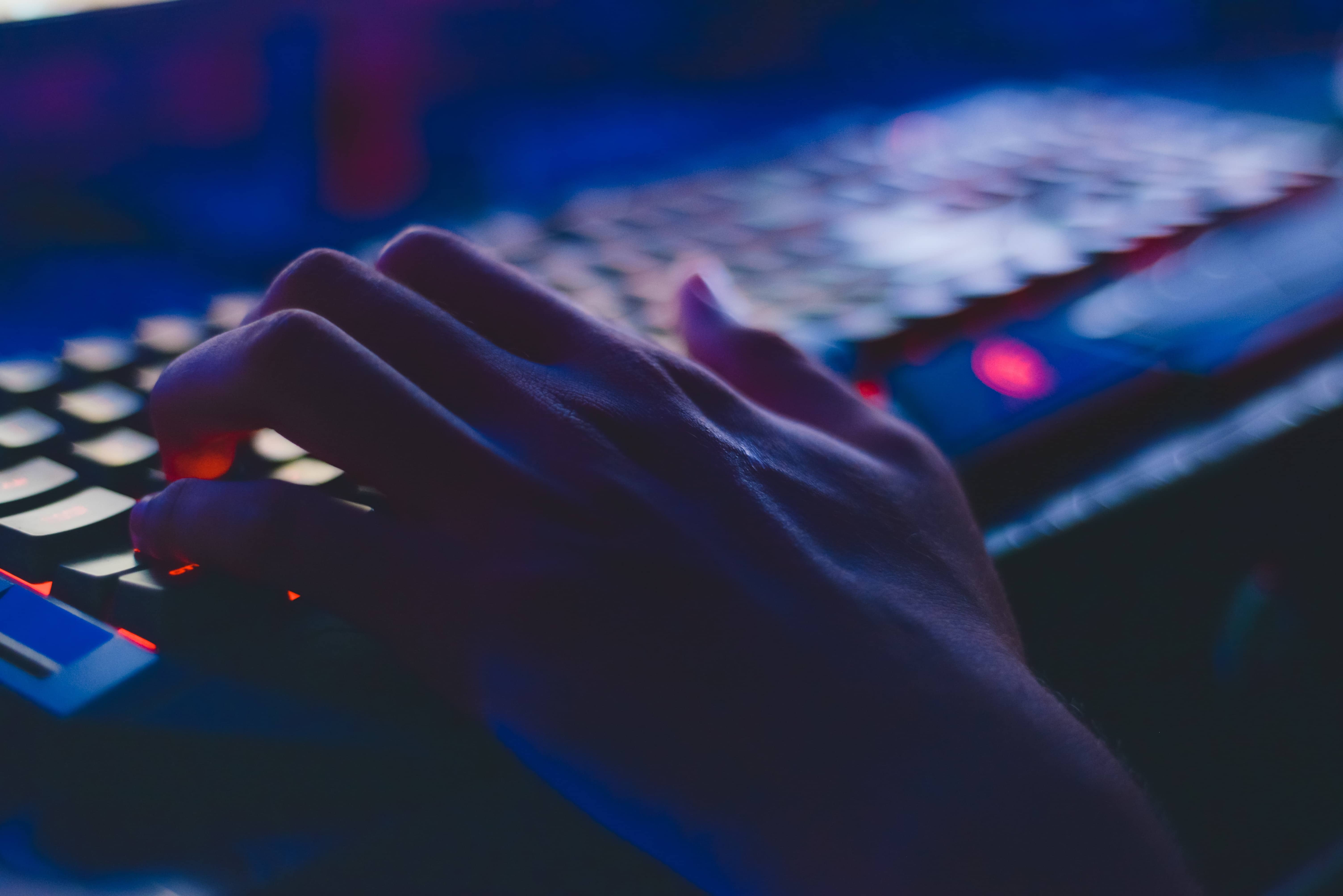 hacker typing on computer keyboard