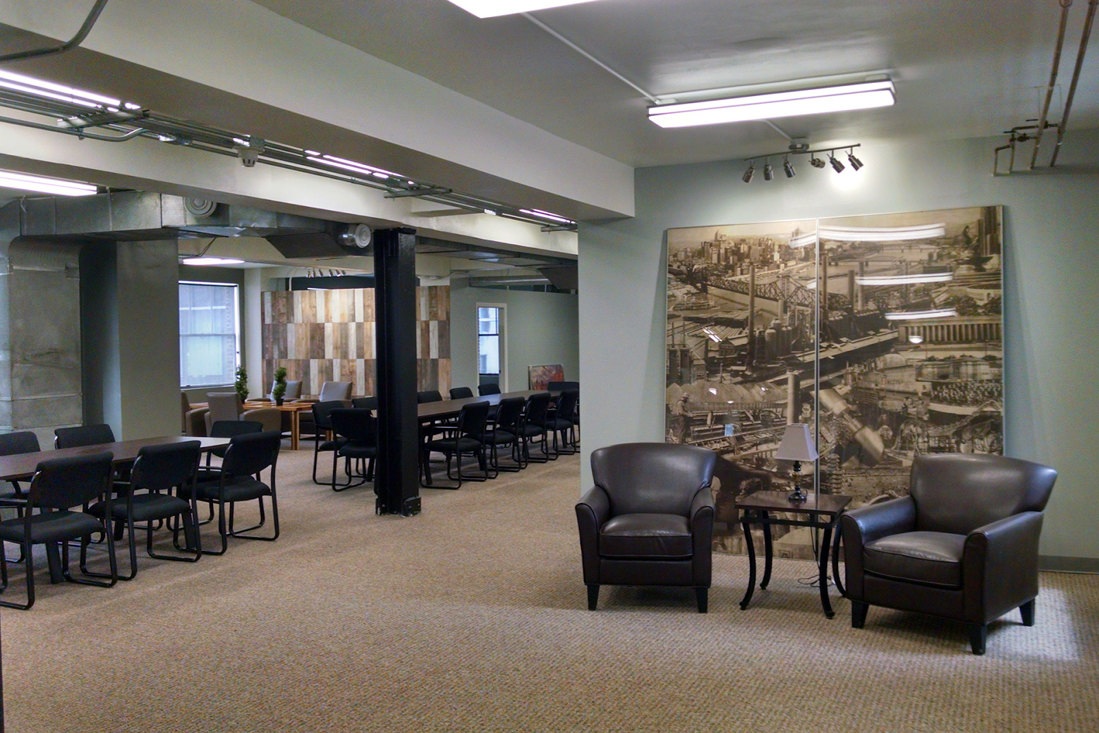 club level coworking space interior with plenty of tables and chairs