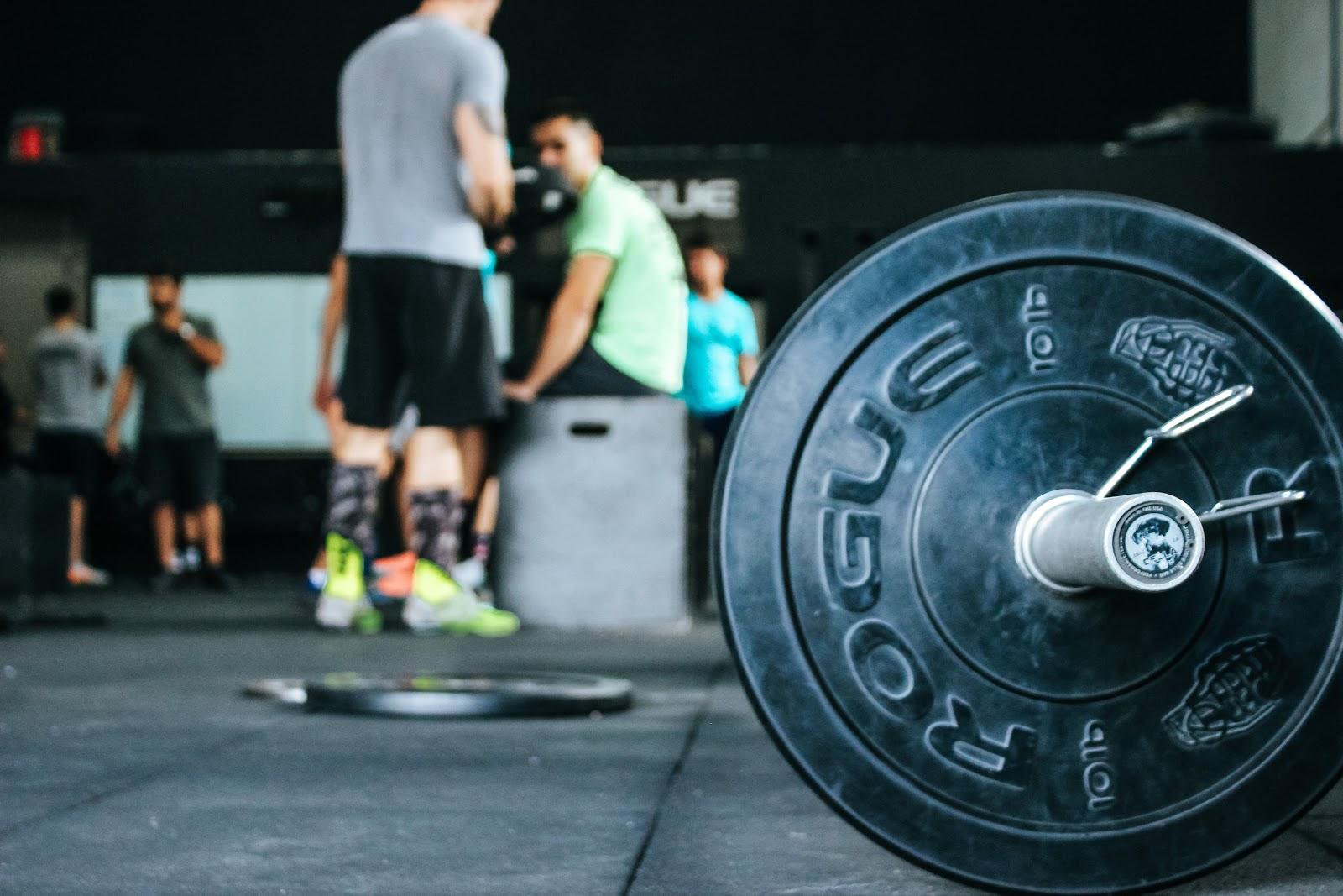 Weight Lifting inside a fitness center