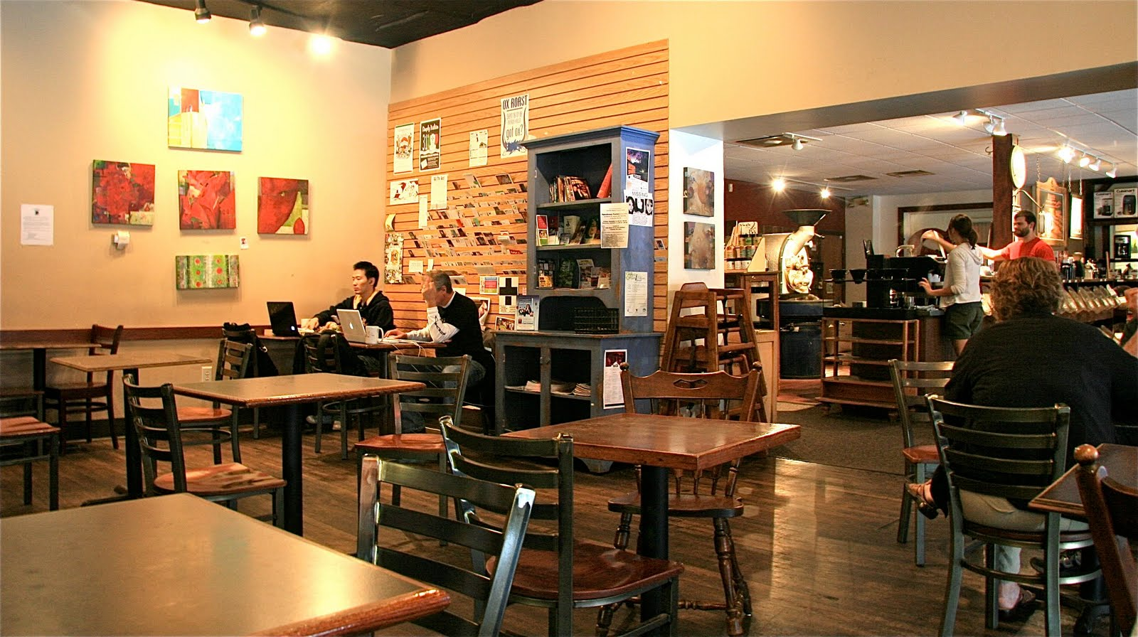 people doing business inside Stauf's coffee shop