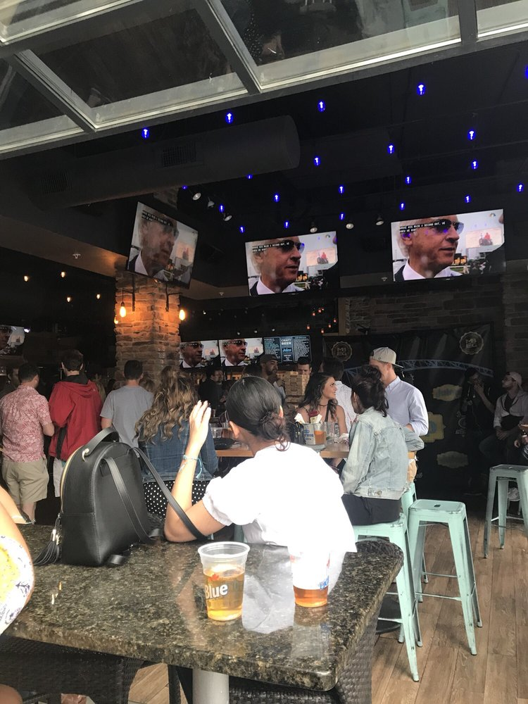 Professionals networking at a bar