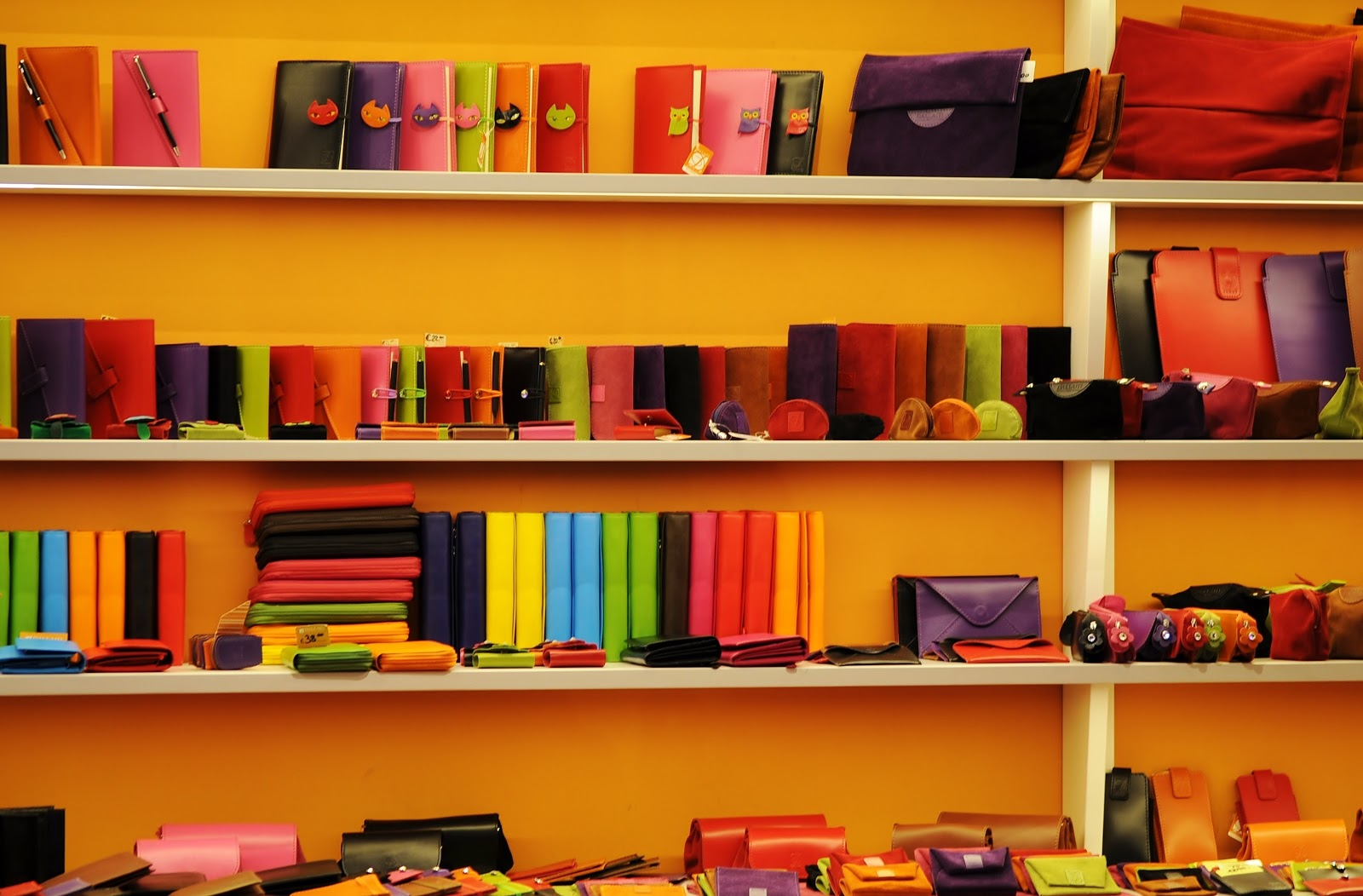 Colorful wallets and purses on shelves