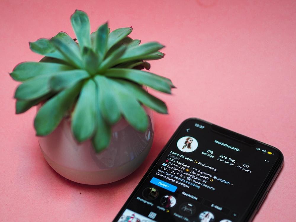 black iphone 4 on white ceramic bowl