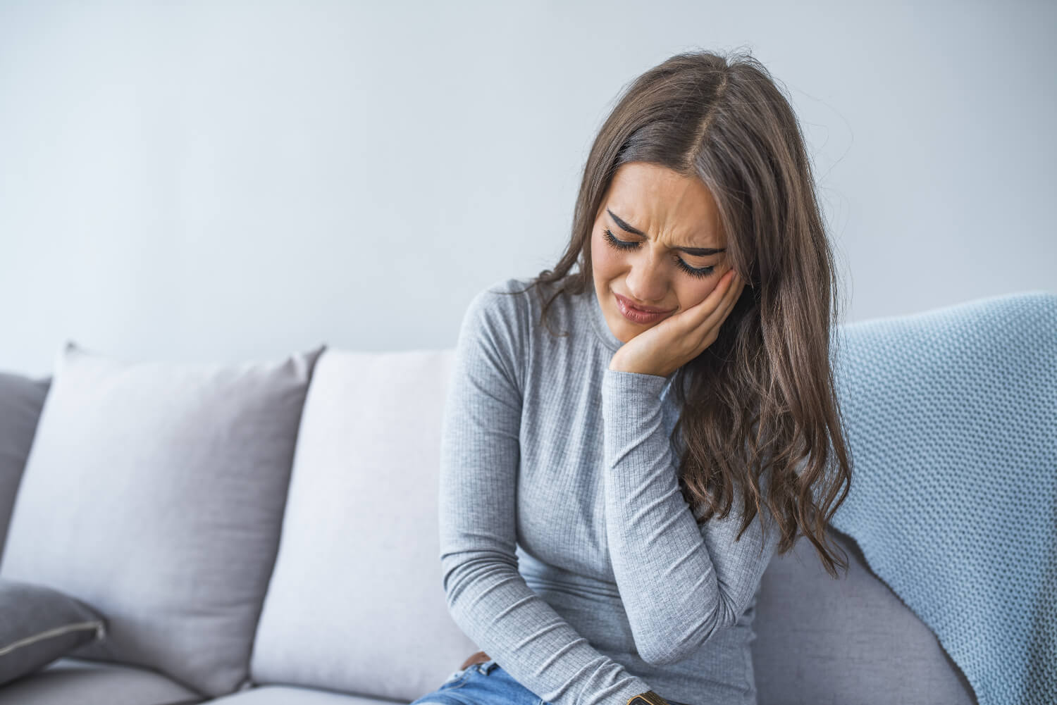 Woman in root canal pain