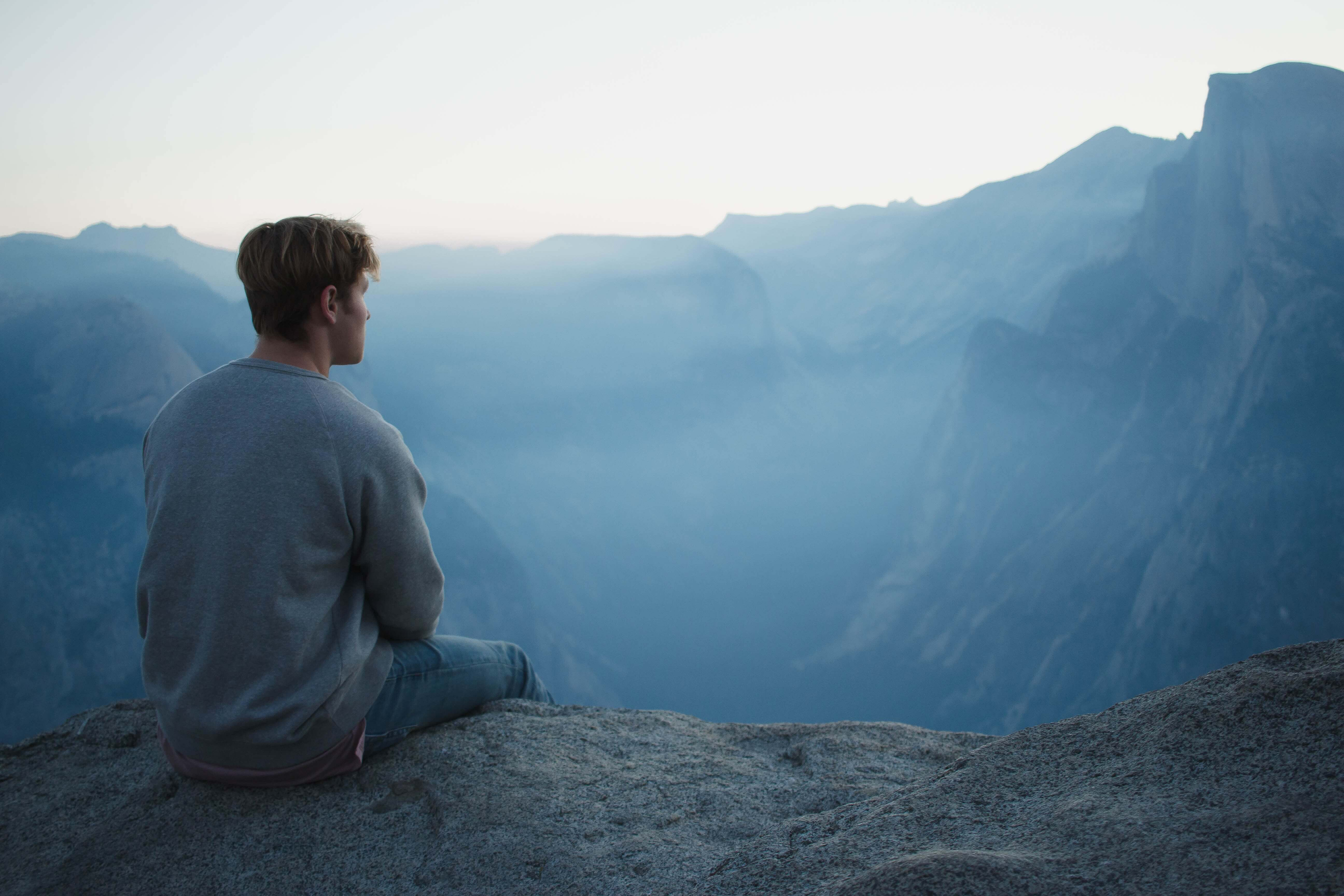 man looking out over land scape