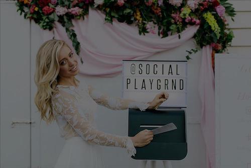 girl at wedding taking instagram print from instagram printer