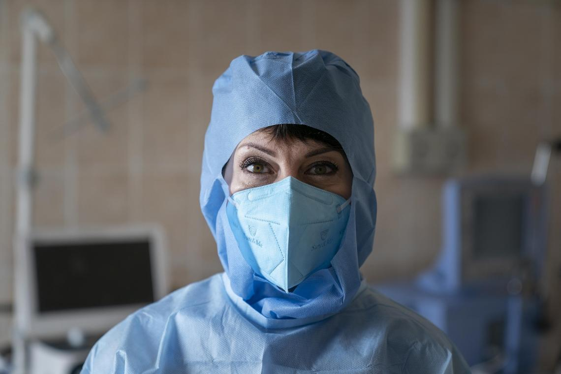 Ukraine. A doctor looks at the camera.
