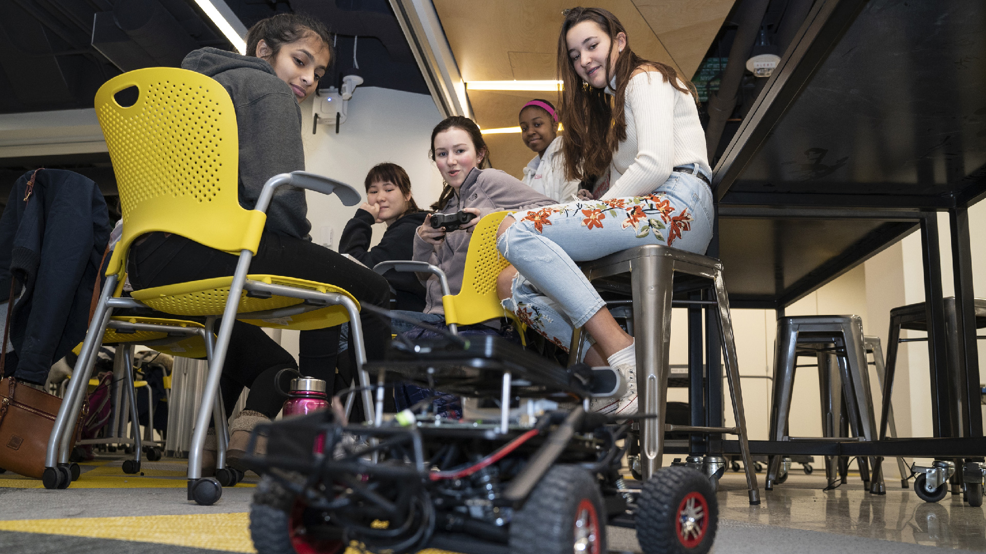Girls program robots in high school