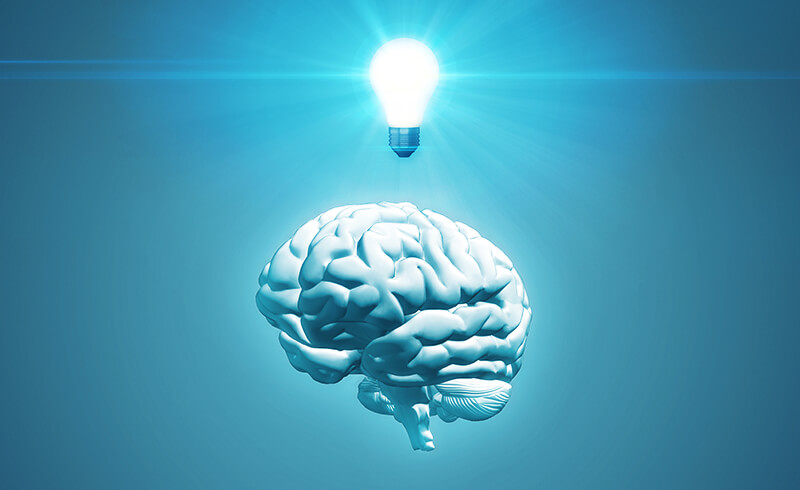 3D render of a white brain on a solid blue background, with a glowing lightbulb floating above.